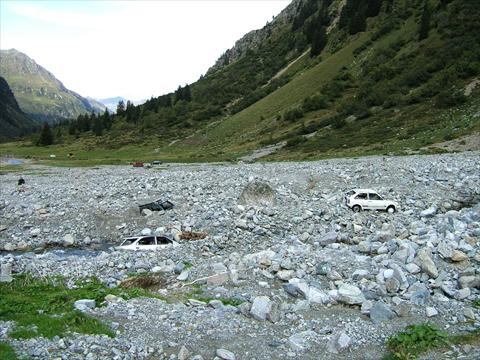 Cars covered by rocks